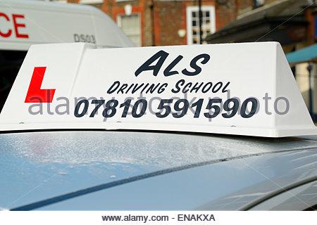 Driving School car roof sign, Blandford Forum, Dorset, England UK - Stock Photo