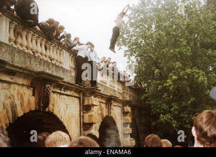 FILE PHOTOS: Oxford, Oxfordshire, UK. 1st May 1995. Oxford May Day. May Morning Celebrations. Revellers jumping - Stock Photo
