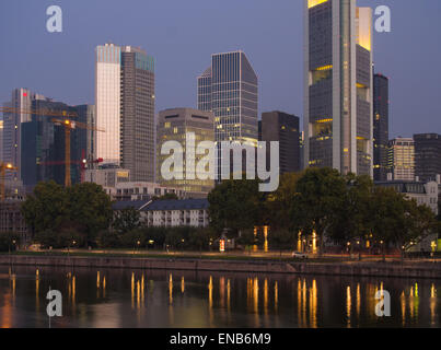 The skyline of Frankfurt, Germany, at the River Main in the morning light - Stock Photo