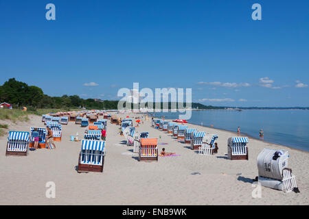 Maritim Hotel and roofed wicker beach chairs along the Baltic Sea at Timmendorfer Strand / Timmendorf Beach, Germany - Stock Photo