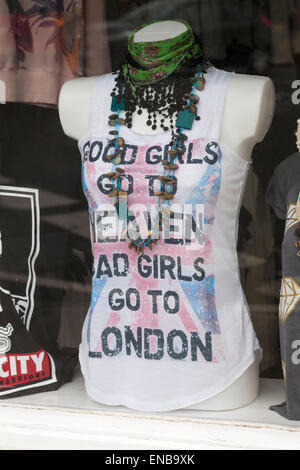 Good girls go to heaven bad girls go to London t-shirt on display in window of shop at Swanage - Stock Photo