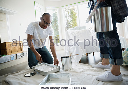 Couple preparing to paint living room - Stock Photo