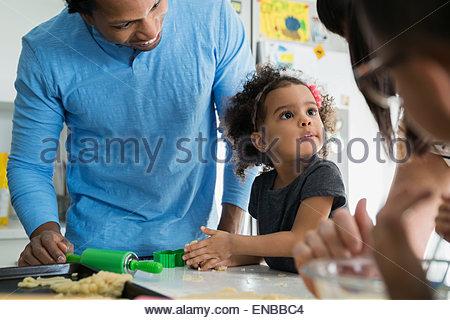 Family baking in kitchen - Stock Photo