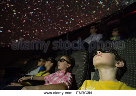 Students in 3D glasses enjoying planetarium show - Stock Photo