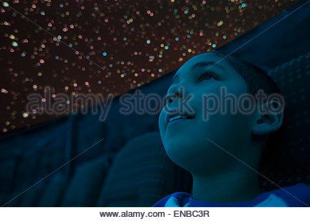 Close up of curious boy enjoying planetarium show - Stock Photo