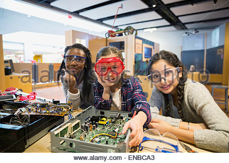 Portrait of girls goggles assembling electronics science center - Stock Photo