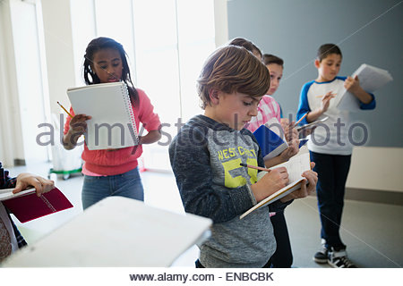 Students taking notes in classroom - Stock Photo