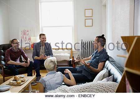 Homosexual and heterosexual couples hanging out living room - Stock Photo
