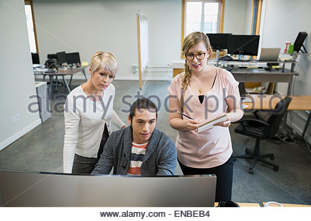 Business people working meeting at computer in office - Stock Photo
