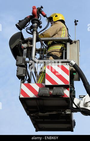 Scottish fire and rescue service aerial rescue platform cage and operator - Stock Photo