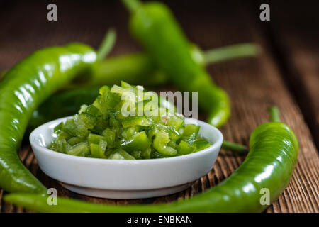 Preserved Green Chilis (in native olive oil) - Stock Photo