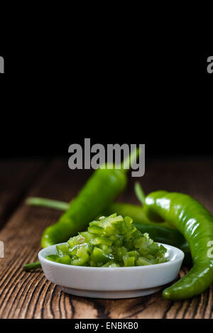 Green Chilis preserved in fresh native olive oil - Stock Photo
