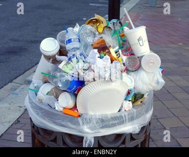 Full garbage can in Washington DC - Stock Photo