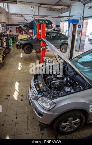 Old style car service with the cars inside - Stock Photo