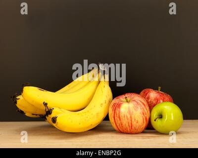 Assorted fruit placed on a wooden surface - Stock Photo