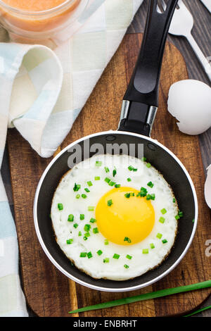 Fried egg made in a small pan - Stock Photo