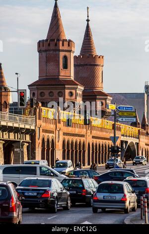 Oberbaumbrücke, a bridge over river Spree, subway, local trains, tram, using the bridge, Berlin, - Stock Photo