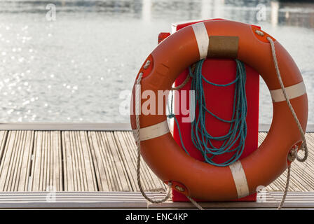 Type IV personal flotation device or life ring or life buoy in position at a Eastbourne marina - Stock Photo