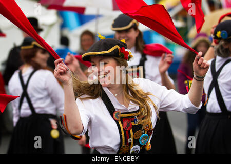 Morris dancer with bib and soft hat in Skipton, Yorkshire, UK 2nd May, 2015. Felicity from Briggate Morris Dancers - Stock Photo