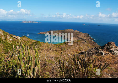 Saint-Barthélemy, French West Indies: the Caribbean Sea and view of the remote beach and bay of Colombier seen from - Stock Photo