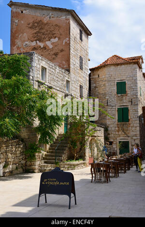 Restaurant on seafront of Stari Grad on Hvar Island on Dalmatian Coast of Croatia - Stock Photo