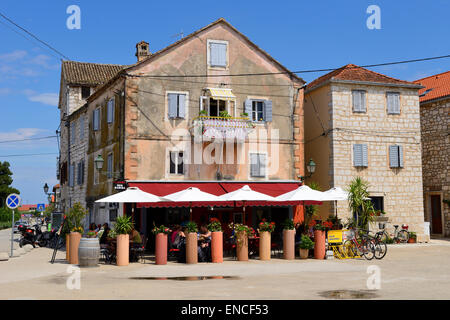 Restaurants on seafront of Stari Grad on Hvar Island on Dalmatian Coast of Croatia - Stock Photo