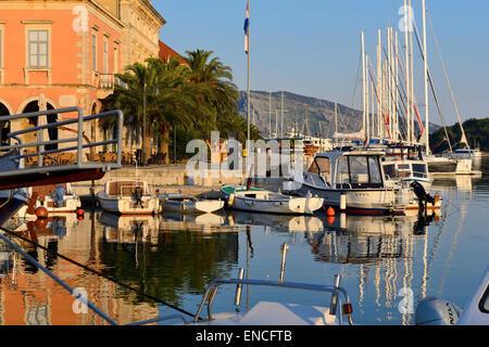 Early morning in Stari Grad harbour on Hvar Island on Dalmatian Coast of Croatia - Stock Photo