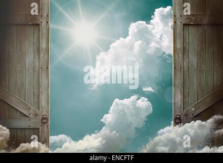 wooden doors open to heaven sky - Stock Photo