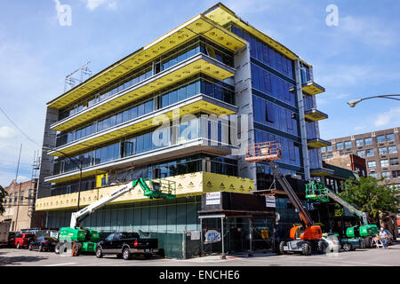 Chicago Illinois Near North Side Downtown building construction site telescopic boom lift aerial work platform cherry - Stock Photo