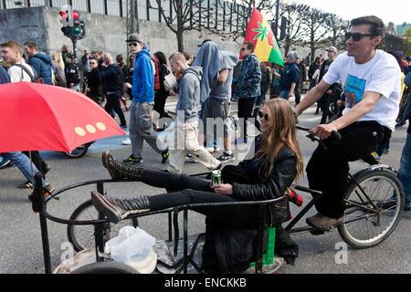 Copenhagen, Denmark. 2nd May, 2015. Participants in the Copenhagen rally for free cannabis. The 3-wheel bike is - Stock Photo