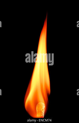 flame of a burning match on black background - Stock Photo