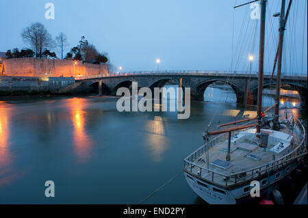 Cardigan castle with ancient bridge over river teifi - Stock Photo