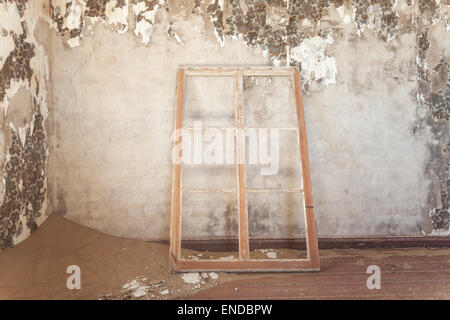 The inside of a deserted house in Kolmanskop, a former diamond town in Namibia. - Stock Photo