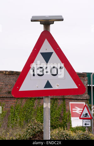 Triangular Road Sign 13 foot Height Restriction - Stock Photo