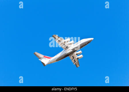 CityJet plane ( British Aerospace Avro RJ85 / BAe 146 ) in the sky - Stock Photo