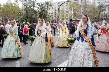 Women in traditional dress during procession at the festival of San Vicente Ferrer, the Patron Saint of the Valencian - Stock Photo