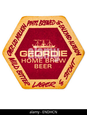 Vintage British Beer Mat advertising Geordie Home Brew Beer - Stock Photo
