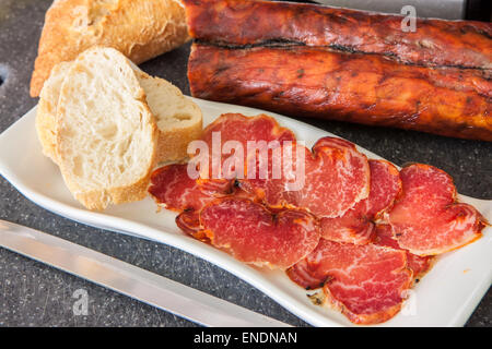 spanish cured tenderloin with paprika on tray - Stock Photo