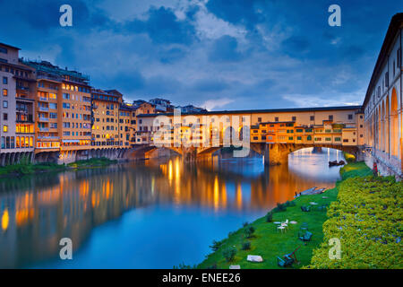 Florence. Image of Ponte Vecchio in Florence, Italy  at dusk. - Stock Photo