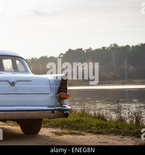 Old retro or vintage car or automobile back side with back light or taillight - Stock Photo