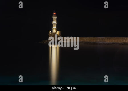 Night view of the old lighthouse at Chania harbor, Greece - Stock Photo