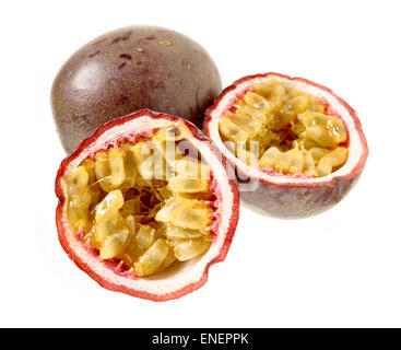 Close up, passion fruit, whole and halves on white background - Stock Photo
