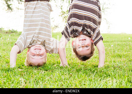 two boys upside down - Stock Photo
