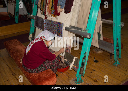 Trainee carpet weaver at the Government training centre in Avanos, Turkey - Stock Photo