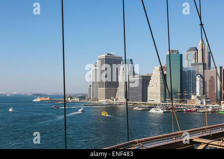 New York, New York State, United States of America.  View from Brooklyn Bridge across the East River to Lower Manhattan. - Stock Photo