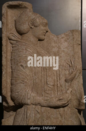 Grave stele. Marble. Greek original of the ionic school. 500-490 BC. Young girl holding a dove in her right hand. - Stock Photo