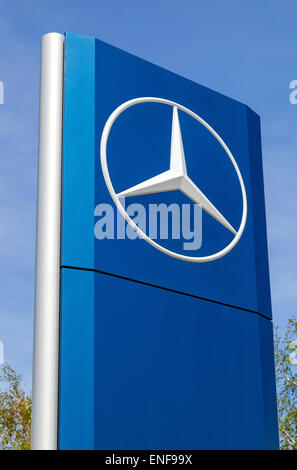 Official dealership sign of Mercedes-Benz.  Mercedes-Benz is a German automobile manufacturer - Stock Photo