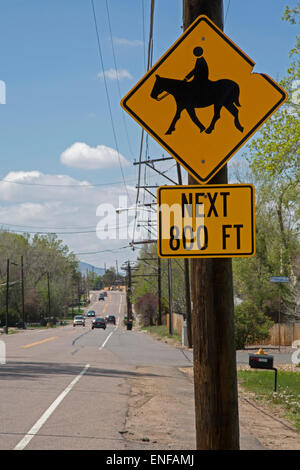 Wheat Ridge, Colorado - A sign in a Denver suburb warns of horseback riders crossing the road. - Stock Photo