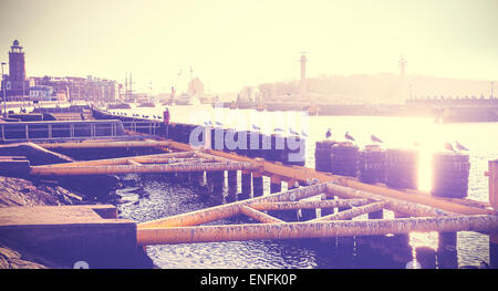 Vintage toned photo of a port infrastructure in Kolobrzeg, Poland. - Stock Photo