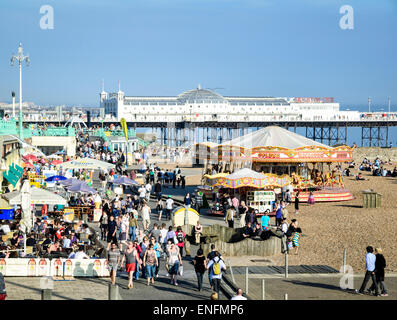 Spring crowds gathering to enjoy the unseasonably hot weather: Brighton Beach, East Sussex, England - Stock Photo